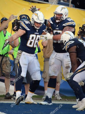 Hunter Henry - Matt Slauson. San Diego Chargers tight end Hunter Henry (86) and center Matt Slauson (68) celebrate in the enzyme after Henry caught a touchdown pass in the end zone in the third quarter of a game against the Miami Dolphins played at Qualcomm Stadium in San Diego on
