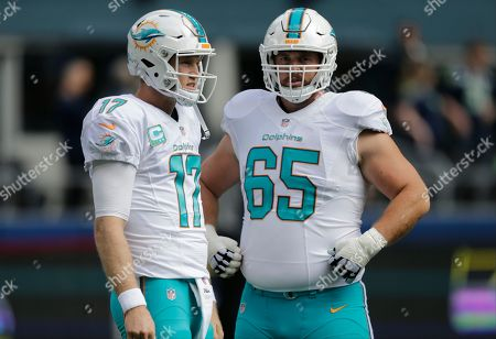 Miami Dolphins quarterback Ryan Tannehill, left, stands with offensive guard Anthony Steen, right, before an NFL football game against the Seattle Seahawks, in Seattle