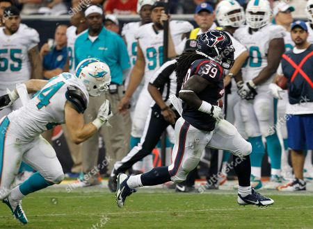 Houston Texans' running back Deji Karim runs downfield during a game against the Miami Dolphins at Reliant Stadium in Houston