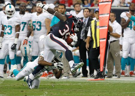 Houston Texans' running back Deji Karim (39) is stopped by the Miami Dolphins' corner back RJ Stanford during a game at Reliant Stadium in Houston