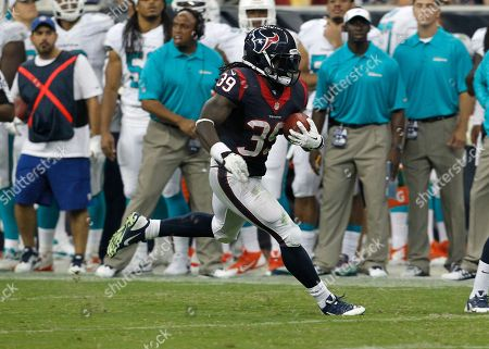 Stock Picture of Houston Texans' running back Deji Karim runs downfield during a game against the Miami Dolphins at Reliant Stadium in Houston