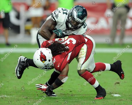 Stock Photo of Emmanuel Acho, Andre Ellington. Philadelphia Eagles linebacker (51) Emmanuel Acho tackles Arizona Cardinals running back (38) Andre Ellington during a game played at University of Phoenix Stadium in Glendale, Ariz. on