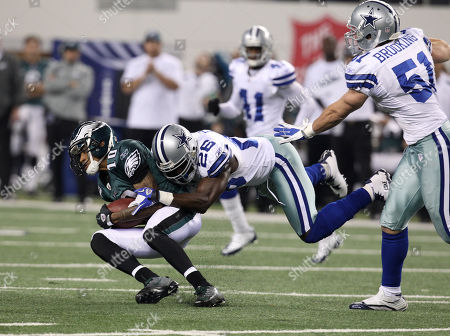 DeSean Jackson, Abram Elam, Keith Brooking. Philadelphia Eagles wide receiver DeSean Jackson (10) is stopped by Dallas Cowboys safety Abram Elam (26) and linebacker Keith Brooking (51) during the second half of an NFL football game, in Arlington, Texas
