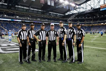 From left, field judge Greg Gautreaux, field judge Jabir Walker, back judge Perry Paganelli, referee John Parry, umpire Mark Pellis, line judge Mark Perlman, and head linesman Greg Bradley pose during pre-game of an NFL football game between the Detroit Lions and the Philadelphia Eagles, in Detroit