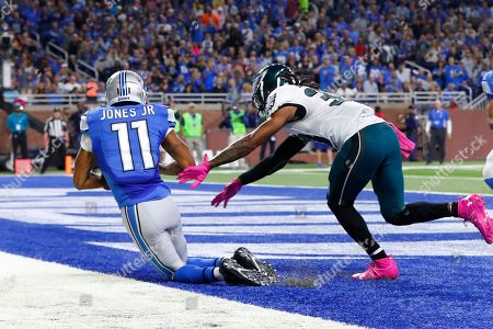 Detroit Lions wide receiver Marvin Jones (11) drags shis feet in the end zone on a one-yard touchdown reception as Philadelphia Eagles cornerback Ron Brooks defends during an NFL football game in Detroit, . Detroit beat Philadelphia 24-23