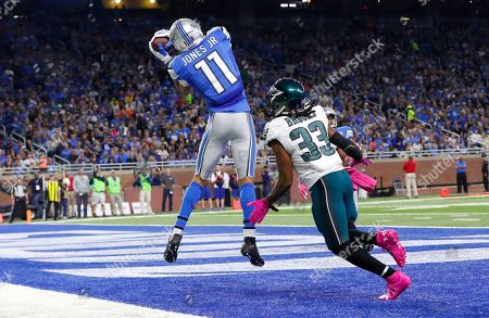 Marvin Jones, Ron Brooks. Detroit Lions wide receiver Marvin Jones, defended by Philadelphia Eagles cornerback Ron Brooks (33) makes a reception for a touchdown during the first half of an NFL football game, in Detroit