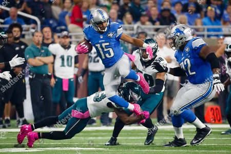 Golden Tate, Ron Brooks. Detroit Lions wide receiver Golden Tate (15) leaps over Philadelphia Eagles cornerback Ron Brooks (33) during an NFL football game at Ford Field in Detroit