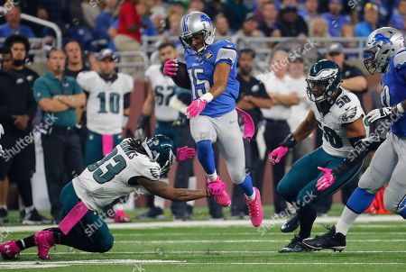 Golden Tate, Ron Brooks. Detroit Lions wide receiver Golden Tate (15) leaps over Philadelphia Eagles cornerback Ron Brooks (33) during the first half of an NFL football game, in Detroit