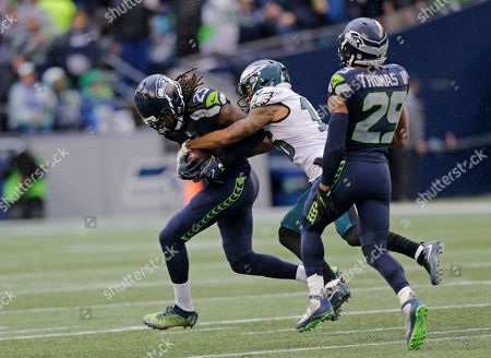 Richard Sherman, Earl Thomas, Bryce Treggs. Seattle Seahawks cornerback Richard Sherman, left, is tackled by Philadelphia Eagles wide receiver Bryce Treggs, center, after Sherman intercepted a pass intended for Treggs in the second half of an NFL football game, in Seattle. Seattle Seahawks free safety Earl Thomas holds his leg on the play at right