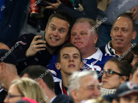 Toronto Mayor Rob Ford, right, poses with a fan during the first half of an NFL football game between the Atlanta Falcons and the Buffalo Bills, in Toronto