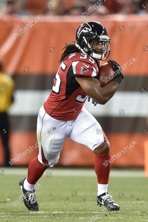 Atlanta Falcons running back Gus Johnson runs the ball in the second half of an NFL preseason football game against the Cleveland Browns, in Cleveland. The Falcons won 24-13