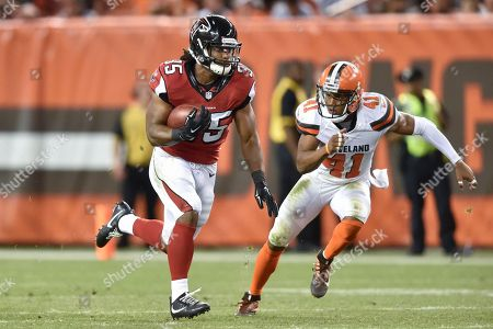 Gus Johnson, Tracy Howard. Atlanta Falcons running back Gus Johnson runs the ball against Cleveland Browns cornerback Tracy Howard (41) in the second half of an NFL preseason football game, in Cleveland. The Falcons won 24-13