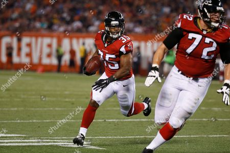 Atlanta Falcons running back Gus Johnson runs the ball in the first half of an NFL preseason football game against the Cleveland Browns, in Cleveland