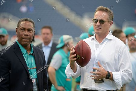 Tom Garfinkel, Nat Moore. Tom Garfinkel, right, Miami Dolphins president and CEO, and Nat Moore watch warmups before an NFL preseason football game against the Atlanta Falcons in Orlando, Fla