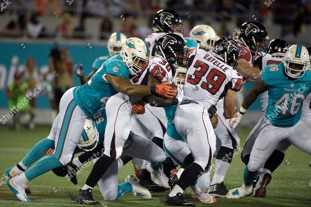 Cyrus Gray, Spencer Paysinger. Atlanta Falcons running back Cyrus Gray (30) is tackled by Miami Dolphins linebacker Spencer Paysinger (42) after rushing for a short gain during the second half of an NFL preseason football game in Orlando, Fla., . The Dolphins won 17-6