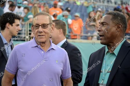 Stephen Ross, Nat Moore. Miami Dolphins owner Stephen Ross, left, and Nat Moore watch warmups before an NFL preseason football game against the Atlanta Falcons in Orlando, Fla