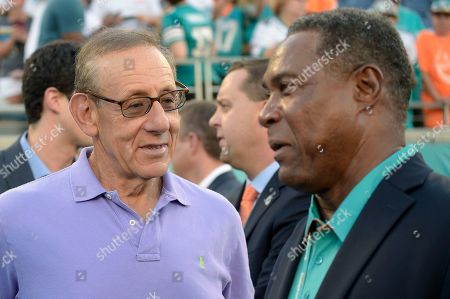Stephen M. Ross, Nat Moore. Miami Dolphins owner Stephen M. Ross, left, chats with former Dolphins wide receiver Nat Moore before an NFL preseason football game against the Atlanta Falcons in Orlando, Fla