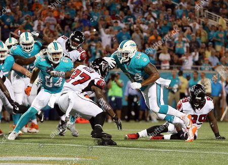 Miami Dolphins running back Arian Foster (34) runs for a touchdown past Atlanta Falcons free safety Ricardo Allen (37) during the first half of an NFL preseason football game in Orlando, Fla