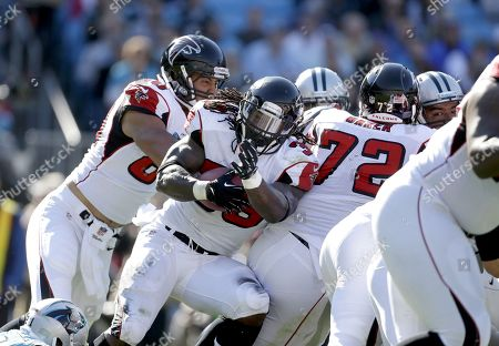 Steven Jackson, Levine Toilolo, Sam Baker. Atlanta Falcons' Steven Jackson (39) protects the football as he pushes for a surge against the Carolina Panthers' defense with teammates, Levine Toilolo (80) and Sam Baker (72) during the first half of an NFL football game in Charlotte, N.C., . The Panthers won 34-10