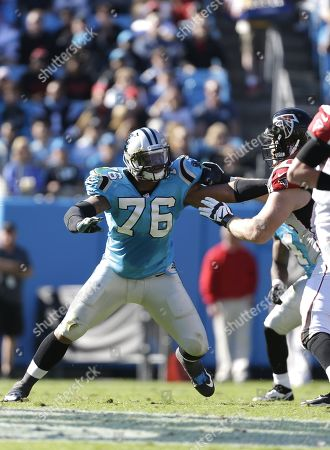 Greg Hardy, Sam Baker. Carolina Panthers' Greg Hardy, left tries to muscle his way around the Atlanta Falcons' Sam Baker during the second half of an NFL football game in Charlotte, N.C., . The Panthers won 34-10