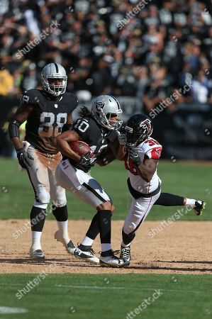 Seth Roberts, Dashon Goldson. Oakland Raiders wide receiver Seth Roberts (10) moves to evade Dashon Goldson in action against the Atlanta Falcons during an NFL football game, in Oakland, Calif. The Falcons won 35-28