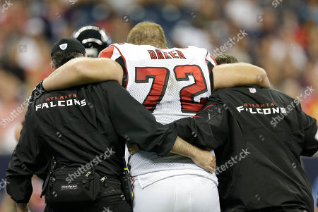 Atlanta Falcons' Sam Baker (72) is helped off the field after he was injured during the second quarter of an NFL preseason football game against the Houston Texans, in Houston