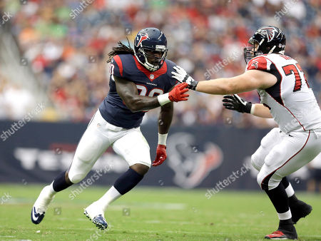Houston Texans linebacker Jadeveon Clowney (90) goes up against Atlanta Falcons tackle Sam Baker (72) during the first quarter of an NFL preseason football game, in Houston