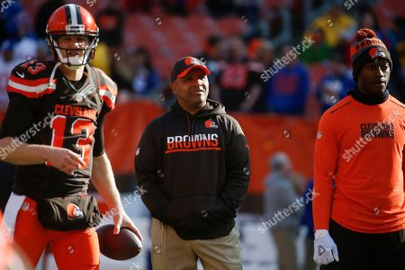 Josh McCown, Hue Jackson, Robert Griffin III. From left, Cleveland Browns quarterback Josh McCown (13), head coach Hue Jackson, and quarterback Robert Griffin III stand on the field during practice before an NFL football game against the New York Giants, in Cleveland
