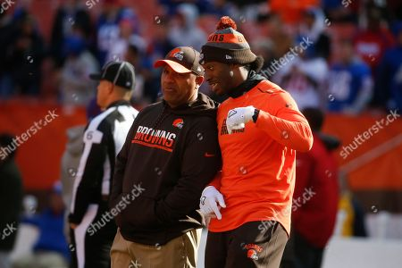 Hue Jackson, Robert Griffin III. Cleveland Browns head coach Hue Jackson, left, and quarterback Robert Griffin III, right, meet on the field during practice before an NFL football game against the New York Giants, in Cleveland