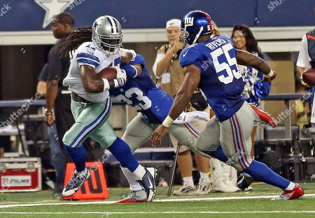 Dwayne Harris, Corey Webster, Keith Rivers. Dallas Cowboys Dwayne Harris #17 runs the ball against New York Giants Corey Webster #23 and Keith Rivers #55 during a game at AT&T Stadium during an NFL game in Dallas, Texas on
