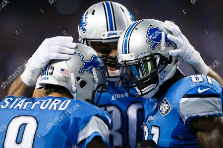 Calvin Johnson, Matthew Stafford, Joseph Fauria. Detroit Lions wide receiver Calvin Johnson, right, celebrates his touchdown with quarterback Matthew Stafford, left, and tight end Joseph Fauria, center, during an NFL football game against the New York Giants at Ford Field in Detroit