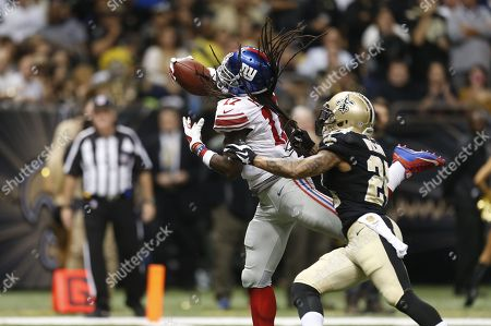 Dwayne Harris, Kyle Wilson. New York Giants wide receiver Dwayne Harris (17) pulls in a touchdown reception over New Orleans Saints defensive back Kyle Wilson (24) in the second half of an NFL football game in New Orleans