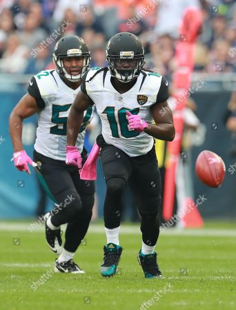 Jacksonville Jaguars running back Denard Robinson (16) chases down a punt during an NFL football game against the Chicago Bears in Chicago, . The Jaguars won the game 17-16