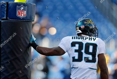 Jacksonville Jaguars running back Richard Murphy stretches before an NFL football game between the Jaguars and the Tennessee Titans, in Nashville, Tenn