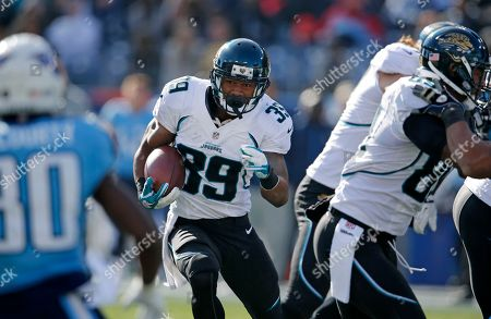 Jacksonville Jaguars running back Richard Murphy (39) carries the ball against the Tennessee Titans in the first quarter of an NFL football game, in Nashville, Tenn