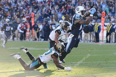 Dorial Green-Beckham, Dwayne Gratz, Johnathan Cyprien. Tennessee Titans wide receiver Dorial Green-Beckham (17) gets past Jacksonville Jaguars defenders Johnathan Cyprien (37) and Dwayne Gratz (27) as Green-Beckham scores a touchdown on a 47-yard pass play in the second half of an NFL football game, in Nashville, Tenn