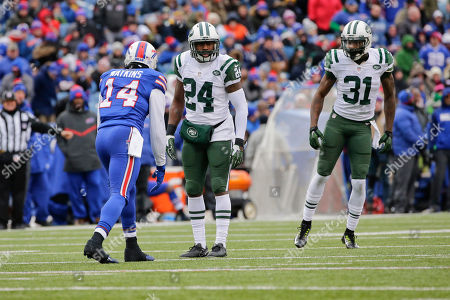 Darrelle Revis, Antonio Cromartie. Buffalo Bills wide receiver Sammy Watkins (14) lines up as New York Jets' Darrelle Revis (24) and Antonio Cromartie (31) watch him during the first half of an NFL football game, in Orchard Park, N.Y