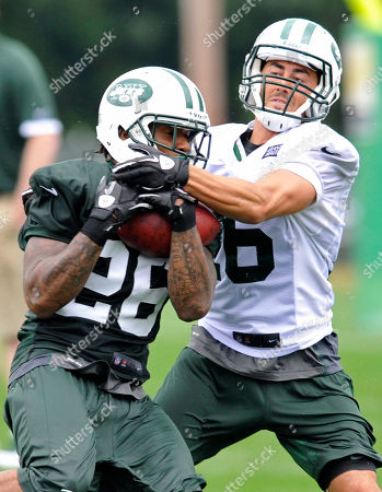 Ellis Lankster, Scotty McKnight. New York Jets cornerback Ellis Lankster, left, intercepts a pass intended for wide receiver Scotty McKnight at their NFL football training camp, in Cortland, N.Y