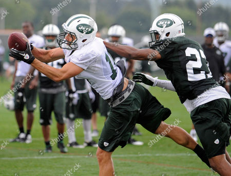 Scotty McKnight, Royce Adams. New York Jets wide receiver Scotty McKnight, left, catches a pass over defensive back Royce Adams at their NFL football training camp, in Cortland, N.Y