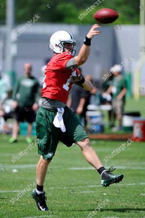 New York Jets quarterback Greg McElroy throws a pass during NFL football practice, in Florham Park, N.J