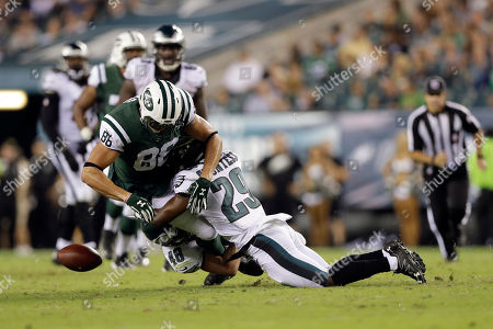 New York Jets' Jace Amaro (88) in action against Philadelphia Eagles' Blake Countess (29), and Don Cherry (48) during the first half of a preseason NFL football game, in Philadelphia
