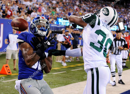 Donald Strickland, Mario Manningham. New York Jets' Donald Strickland, right, breaks up a pass intended for New York Giants' Mario Manningham in the end zone during the third quarter of an NFL preseason football game, in East Rutherford, N.J