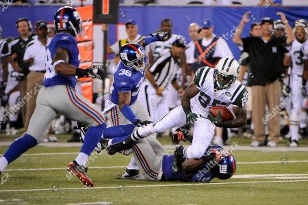 Joe McKnight, Clint Sintim. New York Jets' Joe McKnight, top, is tackled by New York Giants' Clint Sintim, bottom, while New York Jets head coach Rex Ryan, right, reacts during the fourth quarter of an NFL preseason football game between the New York Jets and the New York Giants, in East Rutherford, N.J