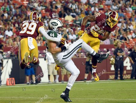 Zach Sudfeld, Lloyd Carrington, Geno Matias-Smith. New York Jets tight end Zach Sudfeld (44) catches a touchdown pass between Washington Redskins safety Geno Matias-Smith (39) and cornerback Lloyd Carrington (25) during the second half of an NFL preseason football game, in Landover, Md