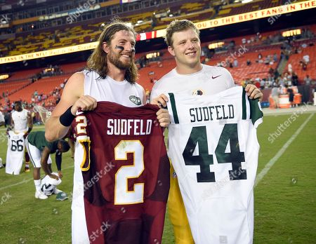 Nate Sudfeld, Zach Sudfeld. Brothers, New York Jets tight end Zach Sudfeld, left, and Washington Redskins quarterback Nate Sudfeld, pose for photographers after exchanging game jerseys, after an NFL preseason football game, in Landover, Md. The Redskins won 22-18