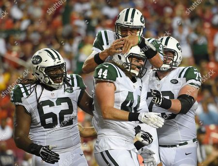 Bryce Petty, Zach Sudfeld, Craig Watts, Brent Qvale. New York Jets quarterback Bryce Petty (9) jumps on New York Jets tight end Zach Sudfeld (44) as they celebrate connecting for a touchdown, with offensive guard Craig Watts (62) and tackle Brent Qvale (79) nearby, during the second half of an NFL preseason football game, in Landover, Md