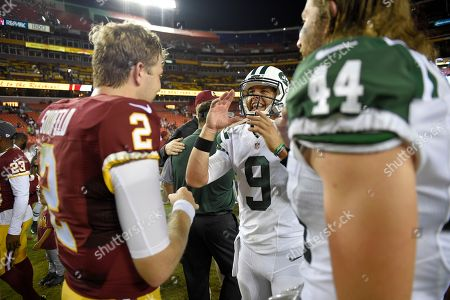Bryce Petty, Nate Sudfeld. New York Jets quarterback Bryce Petty (9) talks with Washington Redskins quarterback Nate Sudfeld (2) after an NFL preseason football game, in Landover, Md. Also seen is New York Jets tight end Zach Sudfeld (44). The Redskins won 22-18