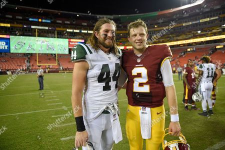 Stock Photo of Nate Sudfeld, Zach Sudfeld. Washington Redskins quarterback Nate Sudfeld (2) and New York Jets tight end Zach Sudfeld (44) pose for photographers after an NFL preseason football game, in Landover, Md. The Redskins won 22-18