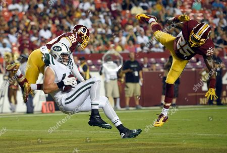 Stock Image of Zach Sudfeld, Lloyd Carrington, Geno Matias-Smith. New York Jets tight end Zach Sudfeld (44) catches a touchdown pass between Washington Redskins safety Geno Matias-Smith (39) and cornerback Lloyd Carrington (25) during the second half of an NFL preseason football game, in Landover, Md
