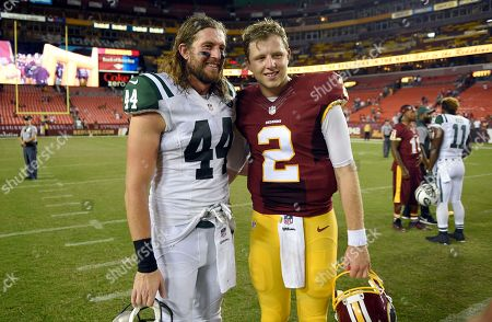 Stock Picture of Nate Sudfeld, Zach Sudfeld. Brothers New York Jets tight end Zach Sudfeld (44) and Washington Redskins quarterback Nate Sudfeld (2) pose for photographers after an NFL preseason football game, in Landover, Md. The Redskins won 22-18